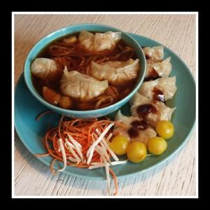 Gyoza (dumplings) gevuld met Panga filet in Aziatische bouillon