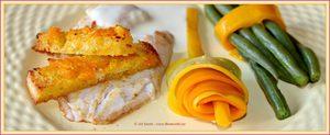Filetto di branzino in salsa di limone, fagioli, zucchine gialle e bruschette al limone.